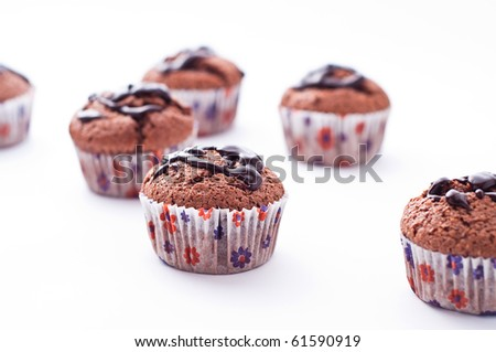 Double chocolate muffins isolated on white