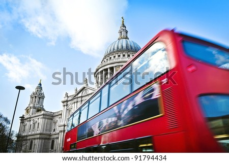 Double decker passing by front of St Paul's Cathedral.