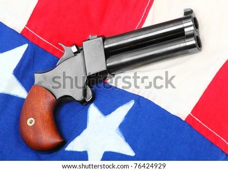 Double derringer pistol on a american flag.