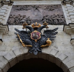 Double eagle with scepter and orb - State Emblem of tsarist Russia Sculpture placed in the Peter and Paul fortress in Saint-Petersburg, Russia