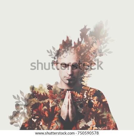 Double exposition man prays. Autumn forest around. Concept of peace, appeasement, yoga, mantra meditation