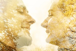 Double exposure art portrait of a young couple looking at each other with the texture of autumn trees with yellow leaves. Romantic, love concept