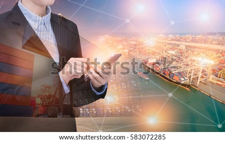 Double exposure asian business woman use smart technology with container shipping boat at shipping yard.Photo concept for Global business containers shipping,Logistic,Import and Export industry.
