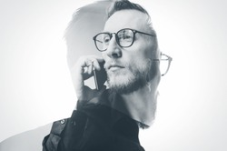 Double exposure bearded banker wearing black shirt and glasses, holding contemporary smartphone hand. Isolated white, portrait man background. Horizontal mockup