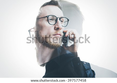 Double exposure bearded banker wearing black shirt and glasses, holding contemporary smartphone hand. Isolated white, portrait man background. Horizontal mockup, color