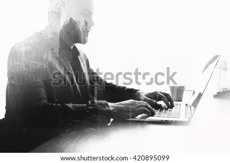 Double exposure black and white effect with young serious man successful trader is monitoring exchange trading via laptop computer. Skilled businessman is working on net-book. Global using of internet