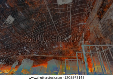 Double exposure Burned interiors of office decoration after fire in the factory / Damage in Factory After Fire Inferno - Burnt warehouse interior #1205593165