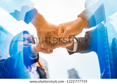 Double exposure Business people of Marketing team with a Partnership greeting power tag team,Teamwork Join Hands Partnership Concept after complete deal,Successful Teamwork Partnership in the city