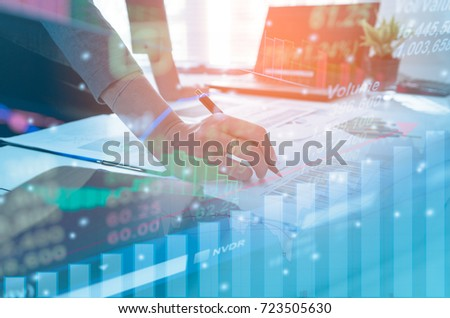 Double exposure business people working at office. Stock markets financial or Investment strategy, Candle stick graph chart of stock market investment trading