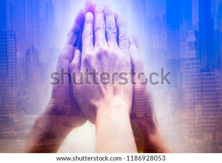 Double exposure Business success Team which hand of the work force combine power tag team or  Group of diversity people hand assemble high five for good teamwork,lens flare image successfuly concept