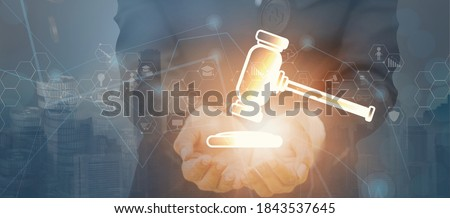 Double exposure businessman hold hammer,stock graph diagram icon,cityscape background,bid winner highest bidder in final lift,public sale property auction business competition,e-auction,online bidding ストックフォト ©