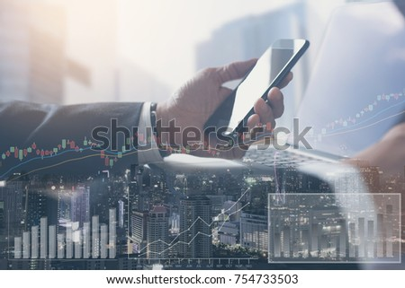 Double exposure, businessman monitoring mobile smart phone, laptop computer with cityscape and financial graph on virtual screen, business trading, stock market  and economic growth analysis concept