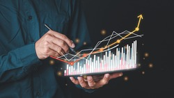 Double Exposure businessman touch virtual screen displaying a crypto currency featuring tickers or graph. Stock chart showing rising stock sign with graph indicator. exchange market data candlesticks.