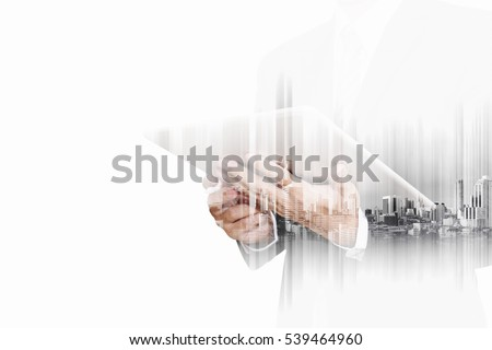 Double exposure businessman working on digital tablet with modern buildings in the city, isolated on white background