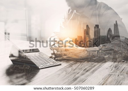 Double Exposure,businessman working with new start up project.using smart phone digital tablet docking keyboard on wooden desk,sun effect