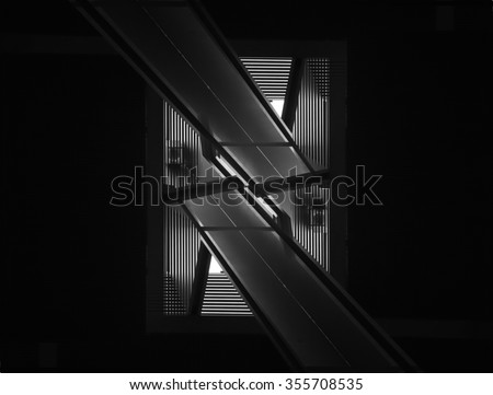 Double exposure closeup of contemporary interior detail. Black and white image of modern architecture in darkness.
