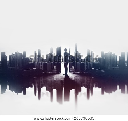 Double exposure concept with businessman and city