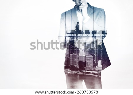 Double exposure concept with thinking businessman
