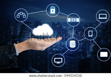 Double exposure hand of professional businessman connected internet and wireless network with his smart phone and city of business background in business trading and technology concept #594314150