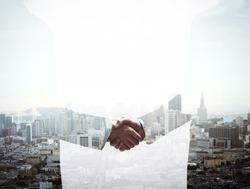 double exposure handshake businessman on city background