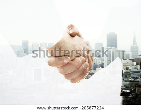 double exposure handshake on a city background