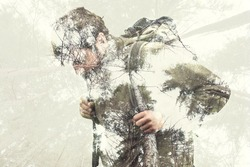 Double exposure hiker into the forest