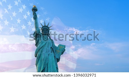 Photo of Double exposure image of American flag and statue of liberty.