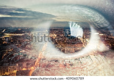 Double exposure image of an eye with city
