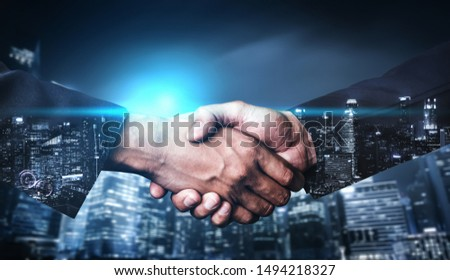 Double exposure image of business people handshake on city office building in background showing partnership success of business deal. Concept of corporate teamwork, trust partner and work agreement. #1494218327