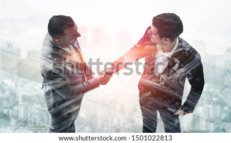 Double exposure image of business people handshake on city office building in background showing partnership success of business deal. Concept of corporate teamwork, trust partner and work agreement. #1501022813