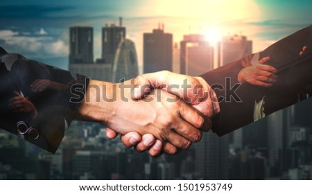 Double exposure image of business people handshake on city office building in background showing partnership success of business deal. Concept of corporate teamwork, trust partner and work agreement. #1501953749