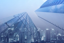 Double exposure, luxury modern highrise buildings and the city can use for business and finance background, blue tone