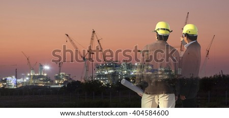 Double exposure man survey or civil engineer stand on ground working over Silhouette Building construction site. examination, inspection, survey