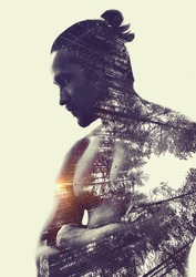 Double exposure :  muscular young man and pine forest