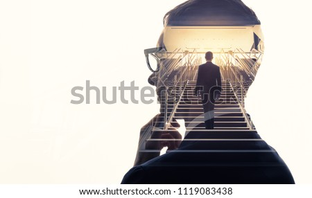 Double exposure of a businessman and stairs. Success of business concept.
