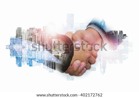 Double Exposure of a businessman handshake on the background blurred downtown nightlife. Concept of an agreement green energy. #402172762