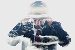 double exposure of  a young business man looking depressed from work, relaxed mountain winter landscape in background