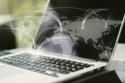 Double exposure of abstract digital world map with connections on laptop background, research and strategy concept