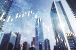 Double exposure of abstract financial graph with world map on office buildings background, forex and investment concept