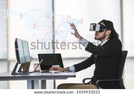 Double exposure of  Asian businessman sitting and viewing the contents of the virtual reality device with icons about map coordinates, concept for geographic technology. #1439933033