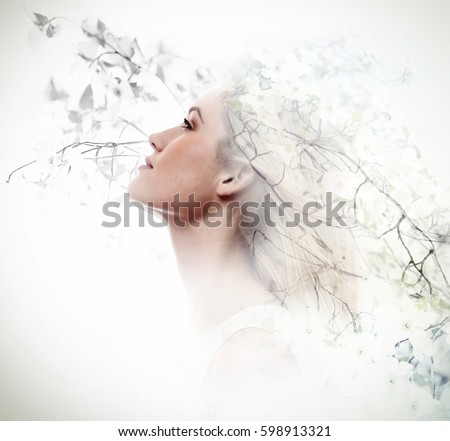 Double exposure of beautiful young woman and dogwood flowers