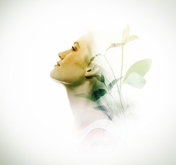Double exposure of beautiful young woman and green leaves