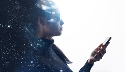 Double exposure of beautiful young woman with smartphone in her hand. Girl browsing internet on smartphone. White background. Free space for text. Abstract portrait. Digital art.