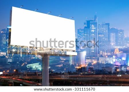 double exposure of blank billboard on city night