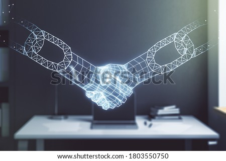 Double exposure of blockchain technology with handshake hologram and modern desktop with laptop on background. Research and development decentralization software concept