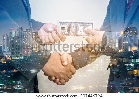 Double exposure of business handshake and give money with city night background - Shutterstock ID 507446794