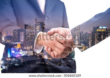 Double exposure of business handshake for successful of investment deal and city night background, teamwork and partnership concept.  - Shutterstock ID 306860189
