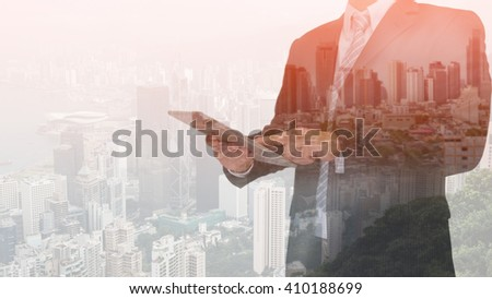 double exposure of business man using tablet and night modern city background #410188699