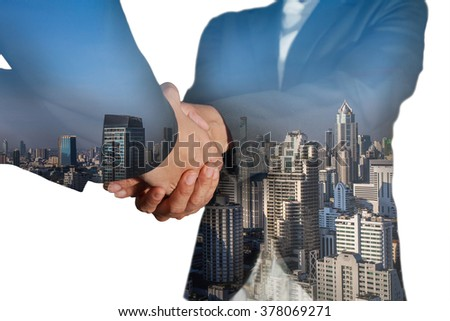 Double exposure of business women double handshake and cityscape as welcome concept. #378069271