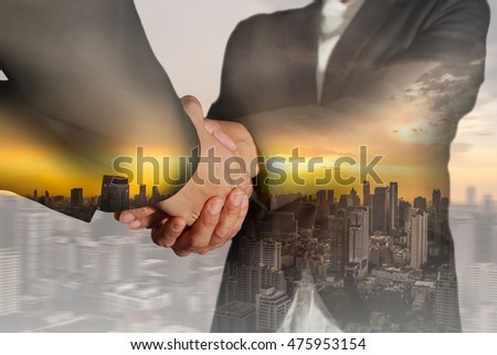 Double exposure of business women double handshake, cityscape and sunset on motion background as Welcome concept. #475953154